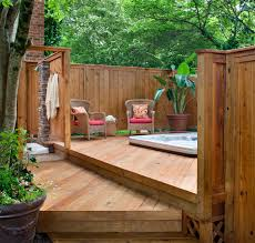 small deck with underground tub and outdoor rattan wicker