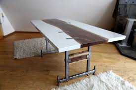 custom dining room table with white concrete black walnut