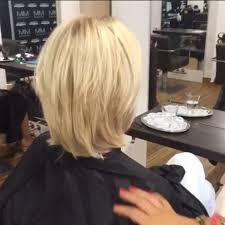 ponytail haircut technique hairdresser at m m friseure salon pulls woman s locks into four