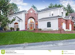 three car garage luxury house exterior with three car garage and driveway stock