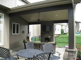 covered patio with fireplace with a roof this olathe patio is simply a whole different outdoor