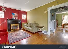 living room red yellow walls fireplace stock photo 128660819