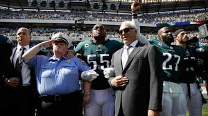 The National by Philadelphia Eagles Players Link Arms During National Anthem