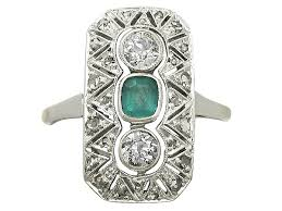 art deco dress ring in platinum with diamonds and emeralds