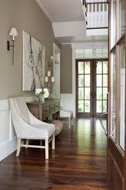dark wood floors and light accents the beige taupe wall is the