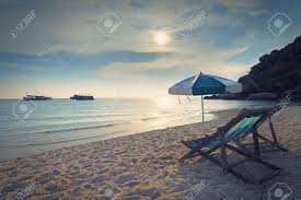 Beach Chair Umbrella Set Wood Chairs Bed And Umbrella On Sand Beach At Sun Set Time Stock