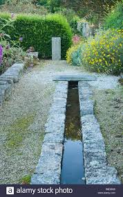 stone edged rills are a feature of the parterre garden beside the