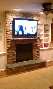 tv above fireplace design ideas images over corner wall mounted tv