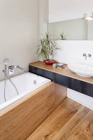 Bathroom Linoleum Ideas by Black Cabinet And Wooden Laminate Flooring Silver Wall Decoration