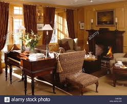 Small Living Room With Fireplace And Piano Antique Spinet Piano Behind Knole Sofa In Comfortable Country