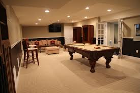 fancy basement game room ideas with wooden pool table and cream