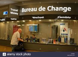 a traveller changing at the bureau de change terminal
