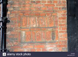 ad1587 date on brickwork at entrance to lion u0026 lamb yard farnham