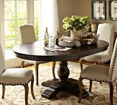 extending pedestal dining table round oval table for eat in nook cortona extending pedestal dining