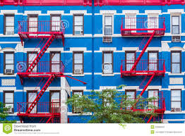 colorful building colorful apartment building in ny with red fire escapes stock