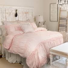 bedroom cream ruched duvet cover with wainscoting and wooden