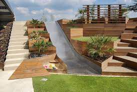Terraced Patio Designs Design Detail A Backyard Slide Among Terraced Planters