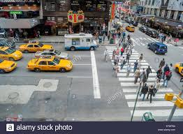 taxi cabs at a busy intersection crosswalk times square new york