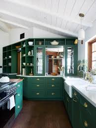 green kitchen cabinets with white countertops green kitchens are a moment architectural digest