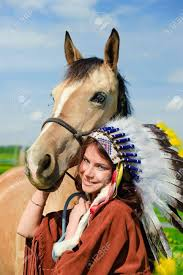 American Indian Petting Her Horse Outside Stock Photo