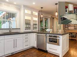 kitchen remodel all white cabinets with alots racs for multi