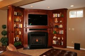 handmade solid wood built in tv wall unit fireplace and bookcase