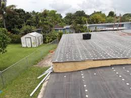 flat roof flat roof with white granulated cap sheet installation roof