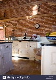 cream double aga oven in barn conversion kitchen with exposed