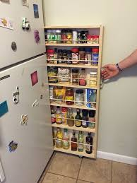 hidden fridge gap slide out pantry food storage shelving and