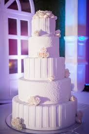 Simple White 5 Tier Wedding Cake Arranged By Signature Designs