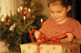 a child opening a christmas gift minden press herald