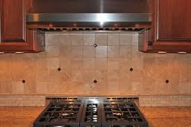 Elegant Kitchen Using Gas Range And Granite Countertops With - Marble backsplashes