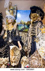 venetian carnival costumes for sale ornate masks used at carnival festival displayed for sale in shop