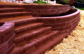 here is a tiered allen block wall with stairs retaining walls