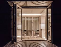this prefab tiny house simplicity its most chic curbed the home facade painted trendy black outside with pale wood paneling within interior foregoes typical tiny house bedroom loft