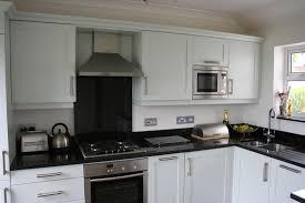 decorations black granite countertop and beige tile backsplash