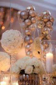 picture of ornaments put into large vases can be centerpieces or