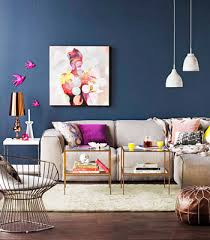 denim blue wall neutral furniture pops of pink and yellow