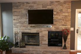 home design exposed beige brick wall along nice fireplace mantel