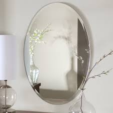 oval shape frameless bathroom wall mirror hang on grey wall color