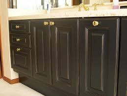 refinishing oak bathroom cabinets dark stain color with door and drawer plus white marble top ideas