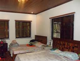 home interior picture using faux wood blinds when combining classic and modern interior