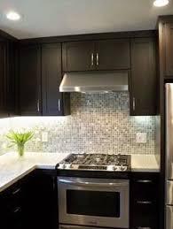 white kitchen cabinets tan countertop kitchens pinterest