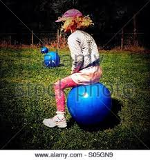 Small Space Hopper - young bouncing on a space hopper england uk stock photo