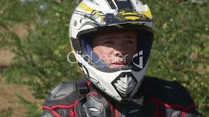 motocross protective gear face of young racer in motorcycle protective gear closeup royalty