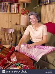 what to get an elderly woman for christmas 1960s middle aged woman wrapping gift smiling christmas wrapping