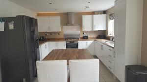 New Design Kitchens Cannock Symphony White Gloss Kitchen With Laminate Oak Block Worktops