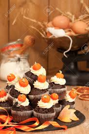 making halloween chocolate muffins for trick or treat night and