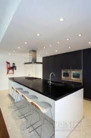 kitchen design by nestor santa cruz with boffi cabinets in dark