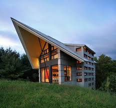 designing quebec countryside slope house with upper and lower